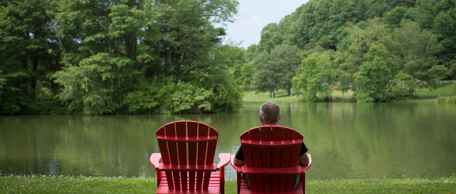 Man in Adirondack Chair at Abbott Lake - Peaks of Otter Lodge