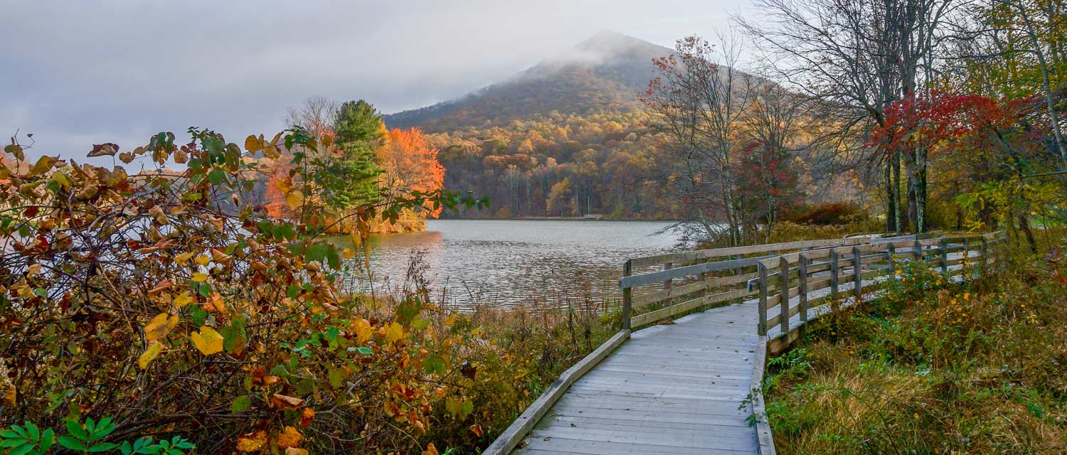 A view of Abbott Lake and Sharp Top Mountain in fall