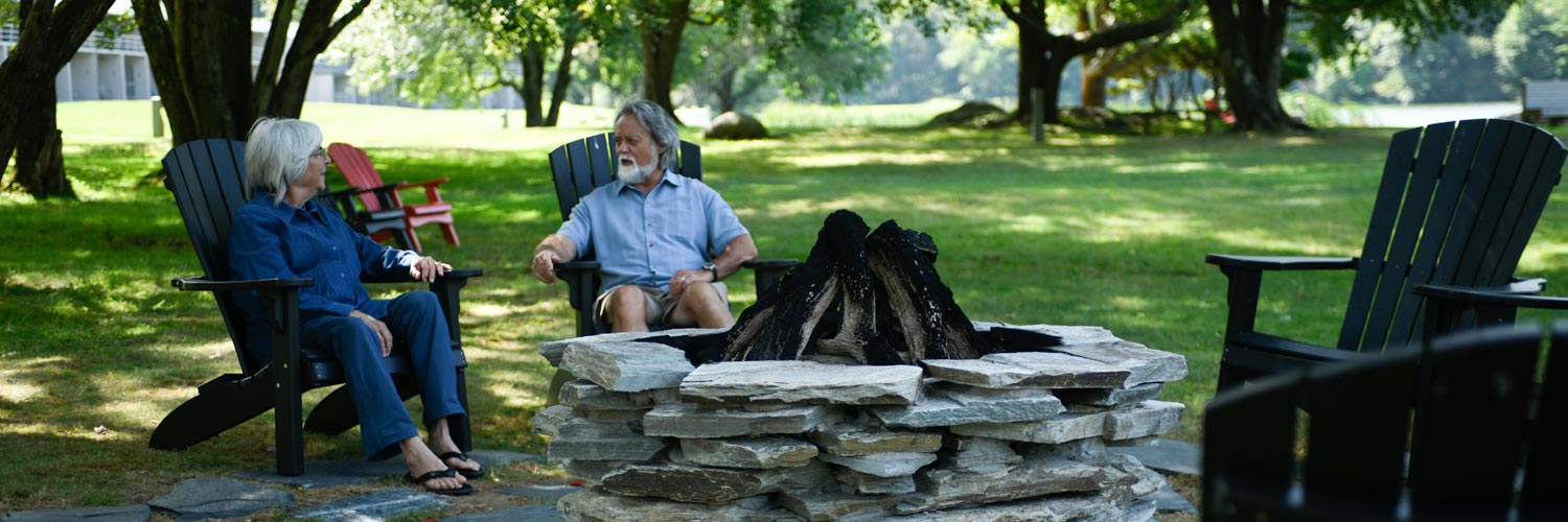 Couple Relaxing Beside Fire Pit at Peaks of Otter Lodge