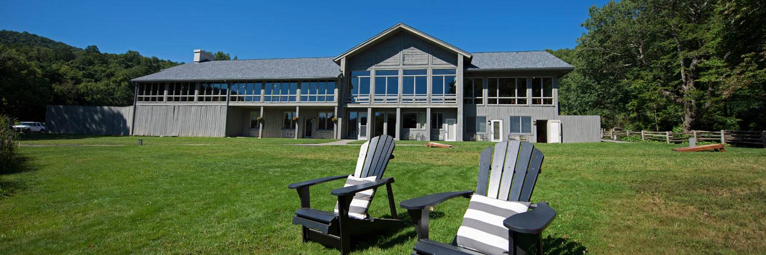 Peaks of Otter Lodge exterior with Adirondack chairs