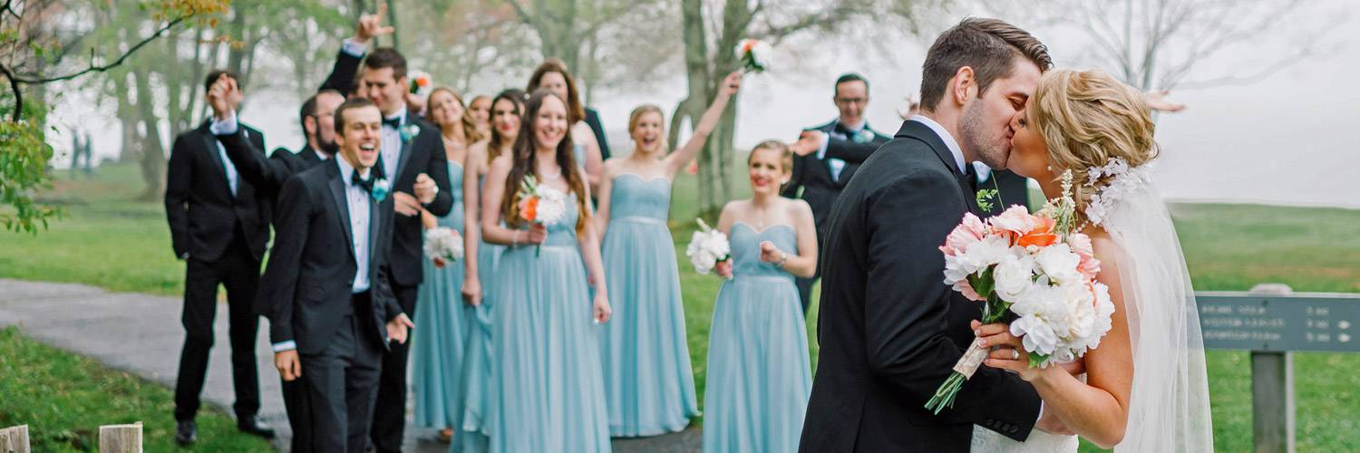 Peaks of Otter wedding guests cheer during bride and groom