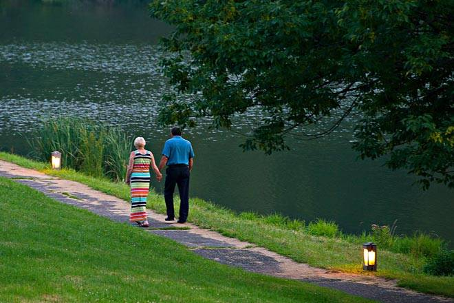 Couple Walking on Path by the Lake
